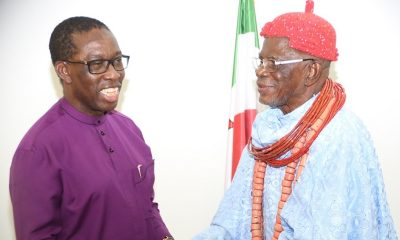Delta State Governor, Senator Ifeanyi Okowa (left), and the Igwe of Okpai, HRM Ugbomah Enebeli Golding ll (right), during a courtesy call by the later on the Governor in Asaba.