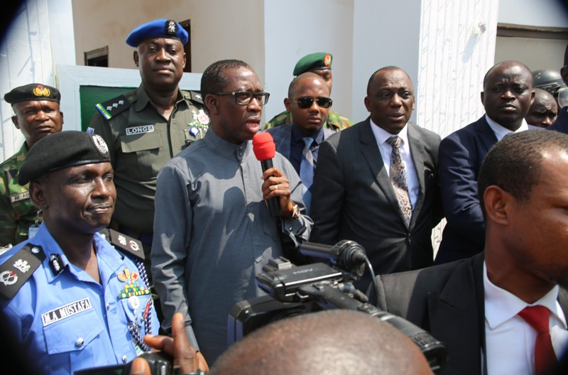 Delta State Governor, Senator Ifeanyi Okowa (2nd left), State Commissioner of Police, Mr Muhammad Mustapha (left), and the Commissioner for Justice, Peter Mrakpor (2nd left), during a protest by the Ijaw, Isoko, itsekiri and Urhobo Ethnic groups to Government House in Asaba.