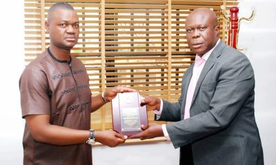 "The Delta State Commissioner, Ministry of Oil and Gas, Hon Freeman Orits Fregene receiving award of ""Outstanding Politician of the Year 2018"" from the Publisher of Warri Voice Newspaper, Mr Femi Odonmeta"